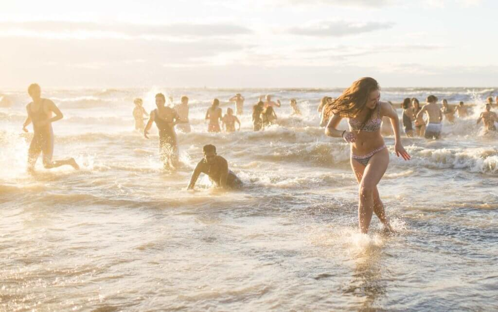 UBC students enjoy the waves at Wreck Beach in Vancouver.